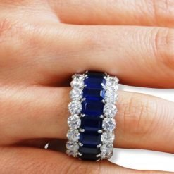 White Topaz and Blue Sapphire Eternity Ring